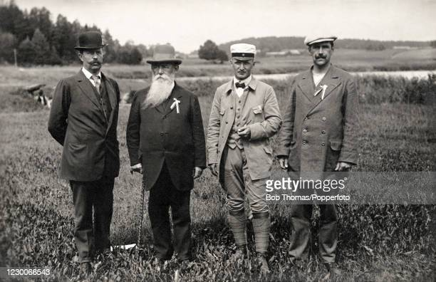 The Swedish gold medal-winning 100 metre running-deer single shot shooting team, comprised of, left to right, Per-Olof Arvidsson, Oscar Swahn, Ake...