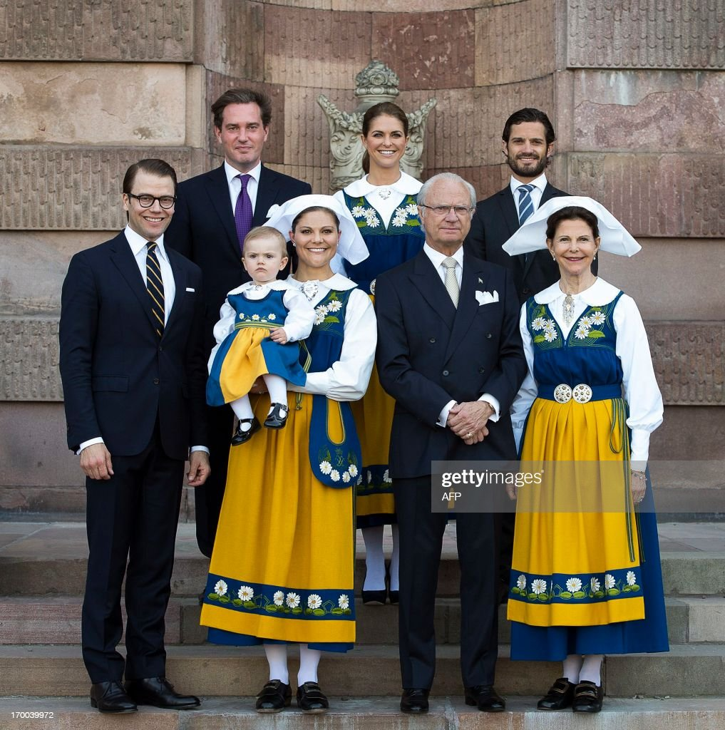 The Swedish Royal family (L-R) Prince Daniel, Chris O'Neill, Princess Estelle, Crown Princess Victoria, Princess Madeleine, King Carl Gustaf, Prince Carl Philip and Queen Silvia pose for a family photo during the Swedish National Day celebrations at the Royal Palace in Stockholm, Sweden, on June 6, 2013.