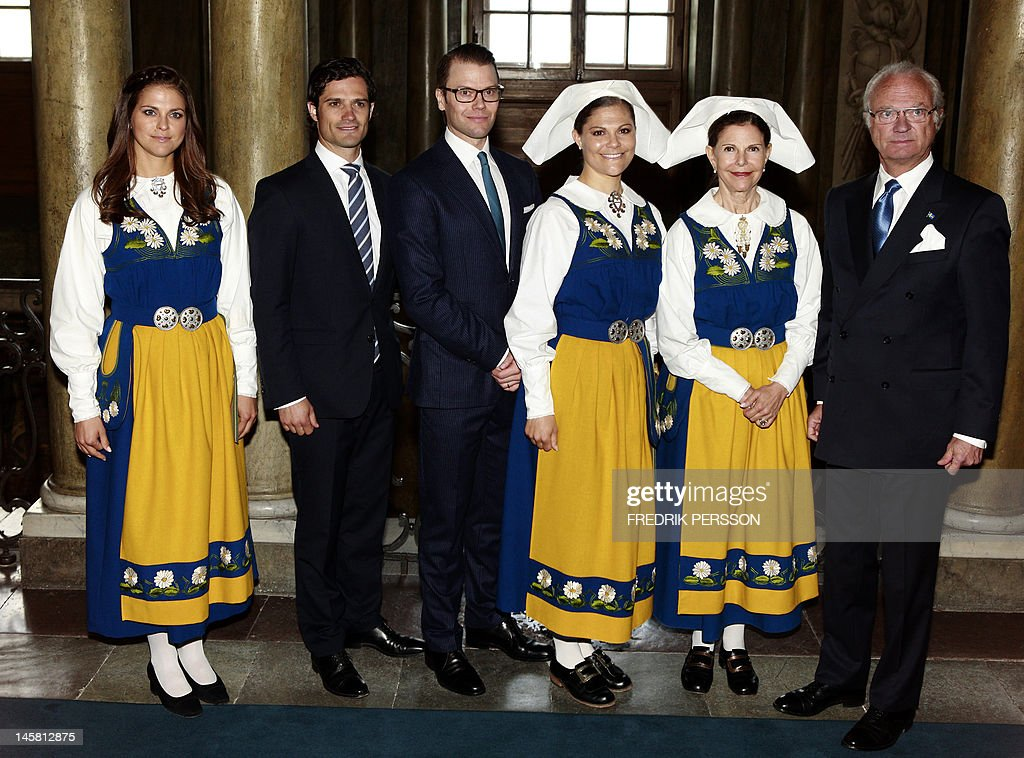 The Swedish Royal family (L-R) Princess Madeleine, Prince Carl Philip, Prince Daniel, Crown Princess Victoria, Queen Silvia and King Carl XVI Gustaf pose before a dinner reception at the Royal Palace in Stockholm to celebrate the Swedish national day in Stockholm, on June 6, 2012.