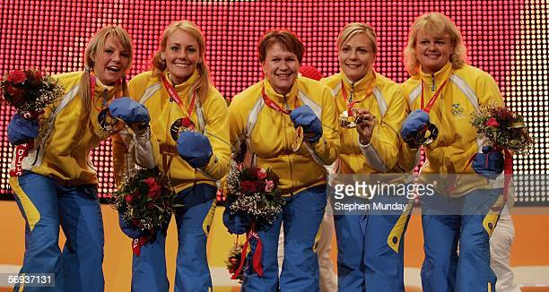 The Swedish team of Anette Norberg Eva Lund Cathrine Lindahl Anna Svaerd and Ulrika Bergman receive the Gold medal the Women's curling at the Medals...