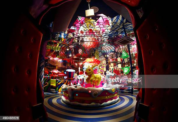 The Sweets Go Round merrygoround stands at the entrance to the Kawaii Monster Cafe operated by Diamond Dining Co in this photograph taken with a...