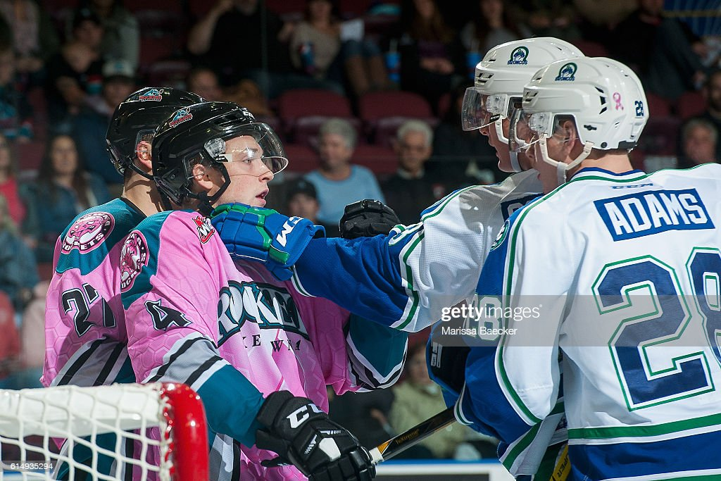 The Swift Current Broncos get in the face of Gordie Ballhorn #4 of Kelowna Rockets on October 15, 2016 at Prospera Place in Kelowna, British Columbia, Canada.