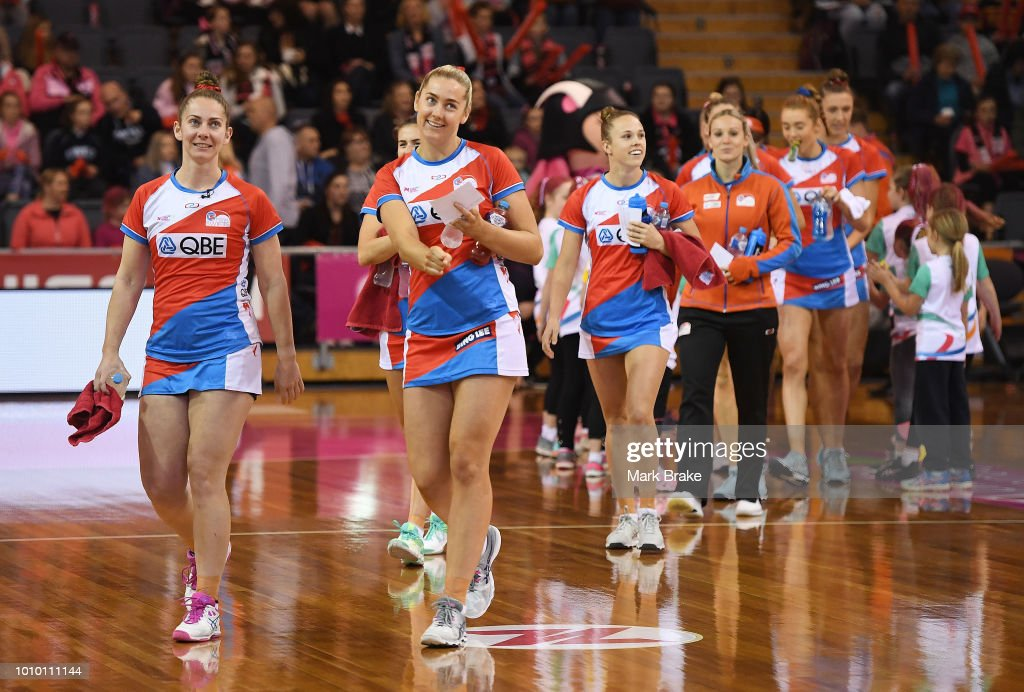 The Swift head onto the court during the round 14 Super Netball