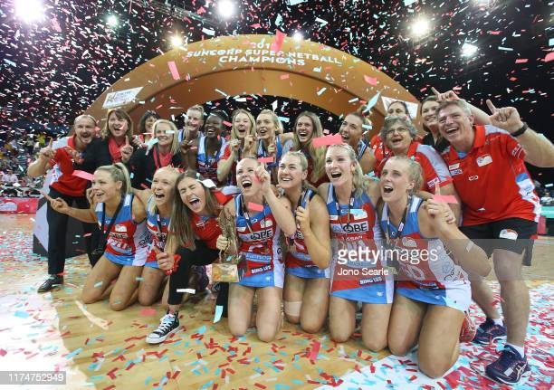 The Swifts celebrate the win with the trophy during the Super Netball Grand Final match between the Sunshine Coast Lightning and the Sydney Swifts at...