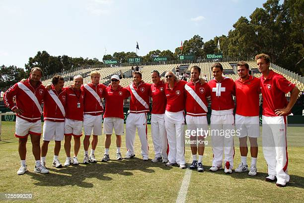 The Swiis team pose after Stanislas Wawrinka won his resumed Davis Cup World Group Playoff Tie match against Lleyton Hewitt of Australia at Royal...