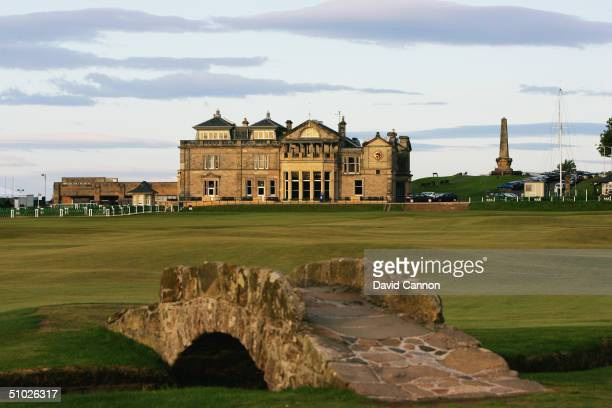 The Swilcan Bridge with the par 4 18th hole and the Royal and Ancient Golf Club of St Andrews Clubhouse behind on the Old Course at St Andrews on...