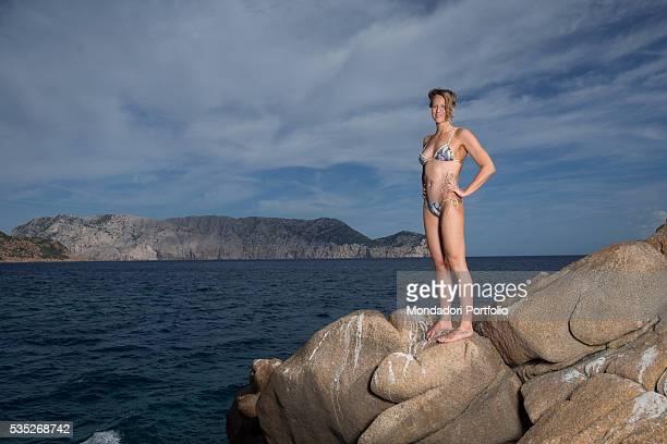 The swimmer Federica Pellegrini on the rocks of the promontory of Capo Coda Cavallo OlbiaTempio Italy 15th August 2015