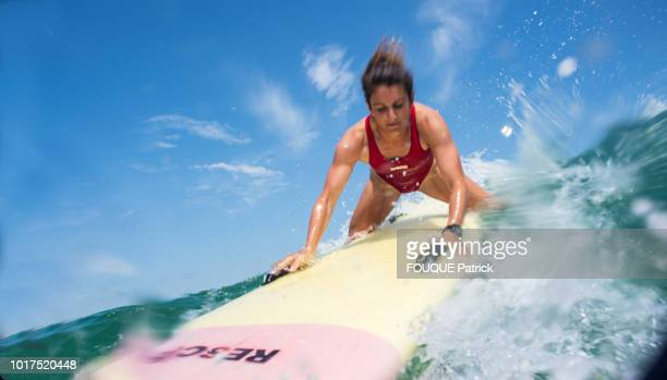 the swimmer lifeguard is photographed for Paris Match a rescue exercise with a paddle on july 08 2018 in Biscarrosse France