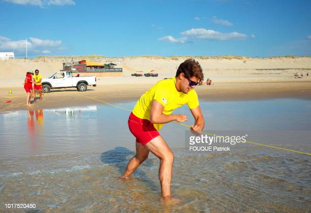 the swimmer lifeguard is photographed for Paris Match a rescue exercise with rope and buoy on the beach on june 07 2018 in Biscarrosse France