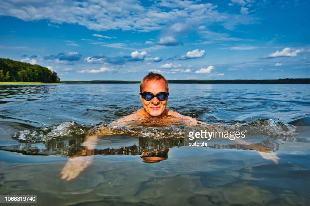 the swimmer - swimming goggles stock pictures, royalty-free photos & images