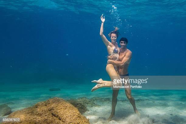 The swimmers Federica Pellegrini and Filippo Magnini hugging each other under the sea in Capo Coda Cavallo OlbiaTempio Italy 15th August 2015
