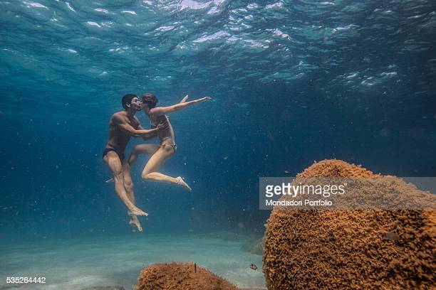 The swimmers Federica Pellegrini and Filippo Magnini kissing each other under the sea in Capo Coda Cavallo OlbiaTempio Italy 15th August 2015