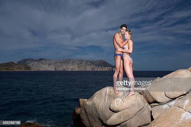 The swimmers Federica Pellegrini and Filippo Magnini on the rocks of the promontory of Capo Coda Cavallo OlbiaTempio Italy 15th August 2015