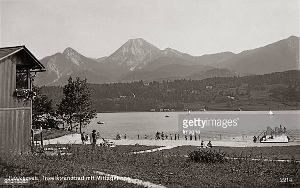 The swimming area of the island in the Lake Faaker See In the background the Kepa peak Carinthia Photograph Around 1930