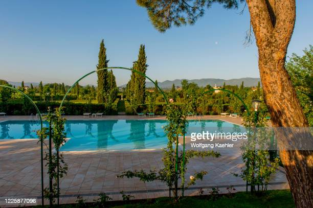 The swimming pool in the garden of the Hotel Villa Zuccari, in the San Luca district of Montefalco, which is a large country house in Umbria, Italy...