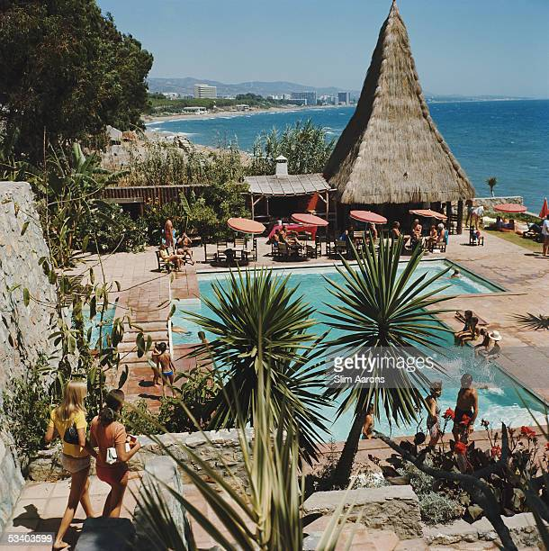 The swimming pool of the Marbella Club in Andalucia looks out over the sea 1976
