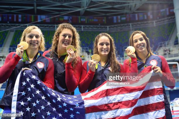 The swimming team of the USA displays their Gold medals after the Women's 4 x 200m Freestyle Relay Final of the Swimming events of the Rio 2016...