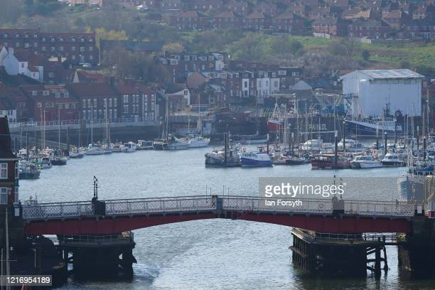 The swing bridge across Whitby Harbour is far emptier than normal as visitors observe the guidelines during the Coronavirus pandemic lockdown on...