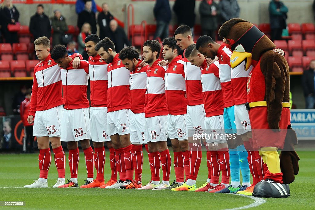 The Swinton Town players stand for two minutes silence ahead of the Sky Bet League One match between Swindon Town and Charlton Athletic at County Ground on November 12, 2016 in Swindon, England.