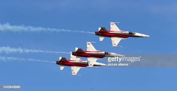 The Swiss acrobatic flight squadron 'Patrouille Suisse' with their Northrop F5E Tiger II jets in action during the first open day at the...