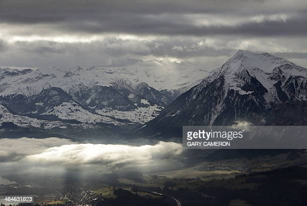 The Swiss Alps are seen from a helicopter near the Swiss ski resort of Davos January 23 2014 AFP PHOTO/POOL/GARY CAMERON