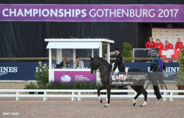 The Swiss dressage rider Charlotte Lenherr on horse Darko of de Niro in action during the dressage Grand Prix at the European Equestrian...