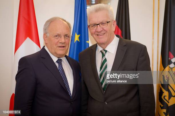The Swiss Federal Council Johann SchneiderAmmann meets Winfried Kretschmann Prime Minister of BadenWuerttemberg at the state ministry in Stuttgart...