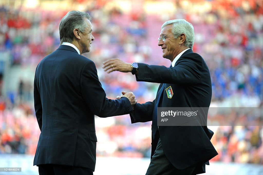 The Swiss National football team coach, Ottmar Hitzfeld (L) shakes hands with Italy's head coach Marcello Lippi, (R) ahead of the friendly match Switzerland vs Italy on June 5, 2010 in the La Praille stadium, in Geneva.