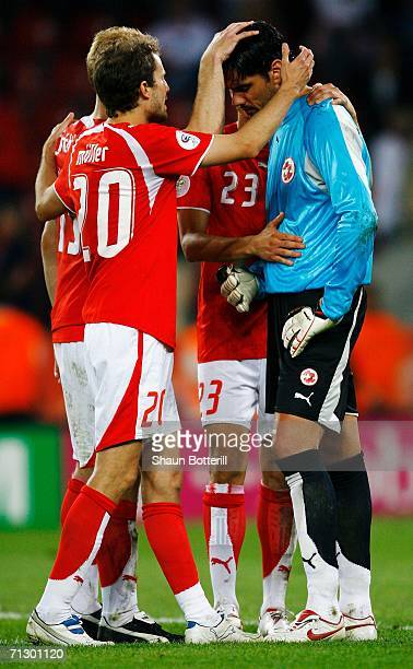 The Swiss players console goalkeeper Pascal Zuberbuehler following their team's defeat in a penalty shootout at the end of the FIFA World Cup Germany...
