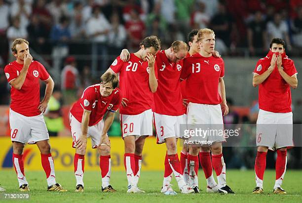 The Swiss players show their dejection following their team's defeat in a penalty shootout at the end of the FIFA World Cup Germany 2006 Round of 16...