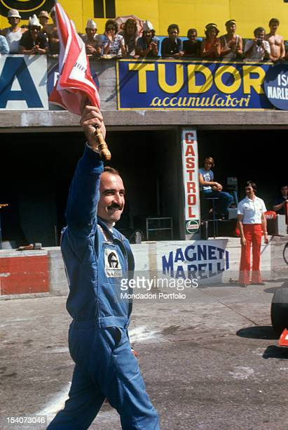 The Swiss racing car driver Clay Regazzoni greeting the crowd before the beginning of the race during the 45th Italian Grand Prix Monza 8th September...