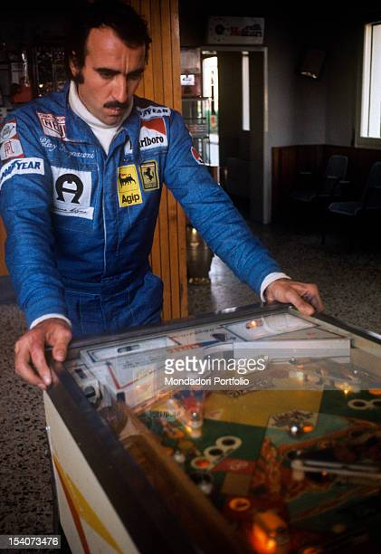 The Swiss racing car driver Clay Regazzoni playing pinball during a break Fiorano May 1974