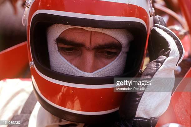 The Swiss racing car driver Clay Regazzoni sitting on board a Ferrari 312 B Fiorano August 1970