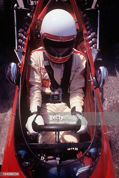 The Swiss racing car driver Clay Regazzoni sitting on board a Ferrari 312 B Monza August 1970