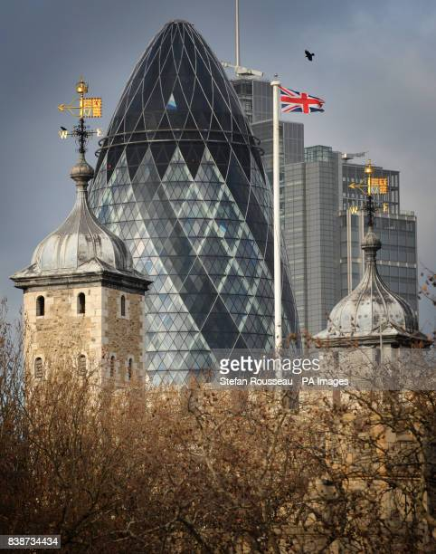 The Swiss Re building also known as the Gherkin and the Tower of London are seen from Tower Bridge in London