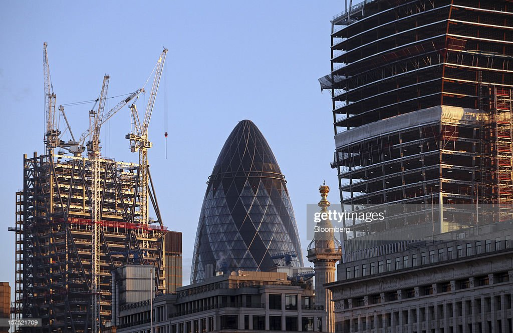 The Swiss Re Insurance building, also known as 'the Gherkin', centre, stands between the construction sites of the Leadenhall Building, left, and 20 Fenchurch Street, or the 'Walkie-Talkie' building, right, in London, U.K., on Friday, Nov. 30, 2012. U.K. banks have become more unwilling to finance development projects without a tenant committed to lease space or a buyer for the completed property. Photographer: Chris Ratcliffe/Bloomberg via Getty Images