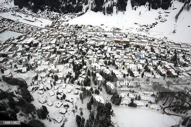 The Swiss resort of Davos stands covered in snow in this aerial photograph taken from a helicopter near Davos Switzerland on Tuesday Jan 22 2013...