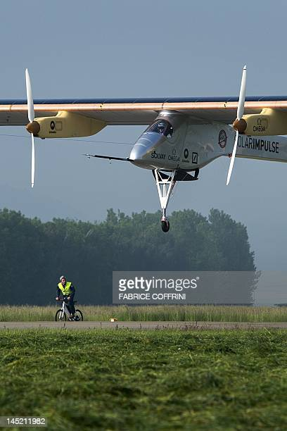 The Swiss sunpowered aircraft Solar Impulse takes off on May 24 2012 in Payerne on its first attempted intercontinental flight from Switzerland to...