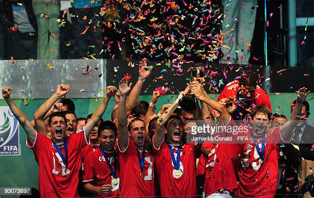 The Swiss team lift the U17 World Cup during the FIFA U17 World Cup Final match between Switzerland and Nigeria at the Abuja National Stadium on...
