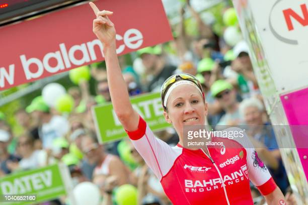 The Swiss triathlete Daniela Ryf crossing first at the finish line in the Datev Challenge Roth in Roth Germany 17 July 2016 In the 15th Roth race...