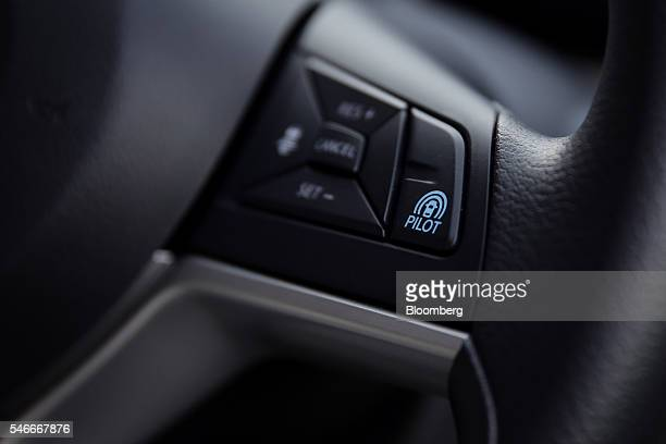 The switch for Nissan Motor Co's ProPilot autonomousdrive technology is seen on the steering wheel of a Serena minivan during a test drive at the...