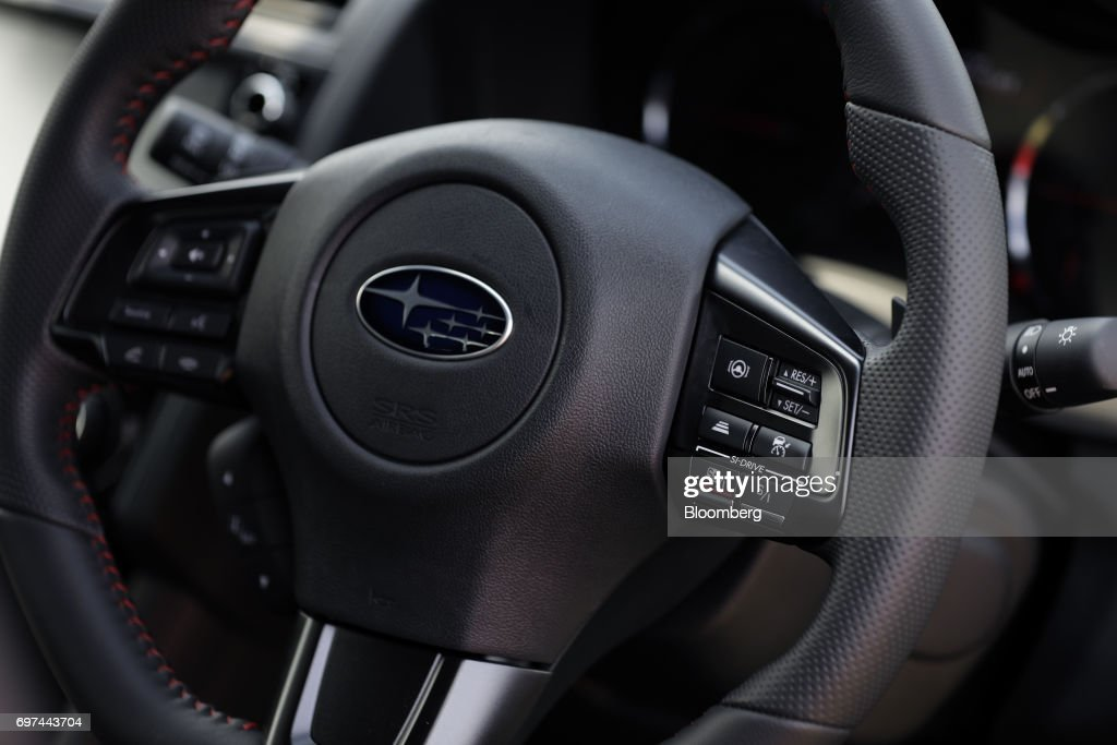 The switches for Subaru Corp.'s EyeSight driving support system are seen on the steering wheel of a prototype WRX S4 sedan during a test drive at Japan Automobile Research Institute's (JARI) Shirosato Test Center in Shirosato, Ibaraki, Japan, on Thursday, June 15, 2017. The EyeSight technology warns drivers when there is potential danger and can apply brakes. Photographer: Kiyoshi Ota/Bloomberg via Getty Images