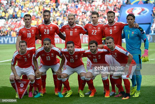 The Switzerland team pose for a team group before the UEFA EURO 2016 Group A match between Romania and Switzerland at Parc des Princes on June 15...