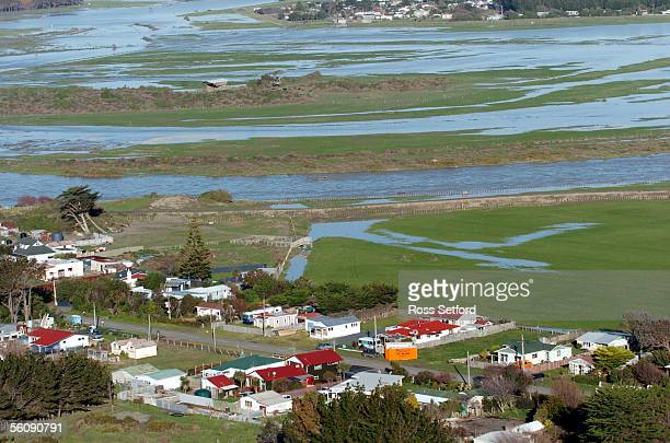 The swollen Rangitikei River flows past Scotts Ferry in the Manawatu New Zealand Thursday July 01 2004 The area was flooded extensively earlier this...