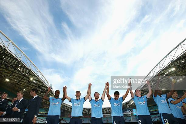 The Sydney FC team celebrate with the crowd after victory during the round 14 ALeague match between Sydney FC and the Newcastle Jets at ANZ Stadium...