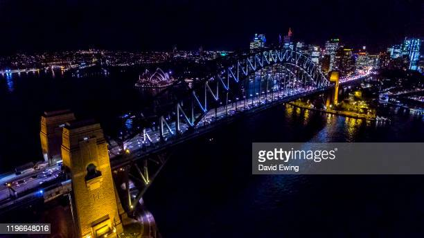 the sydney harbour bridge at night - david ewing stock pictures, royalty-free photos & images