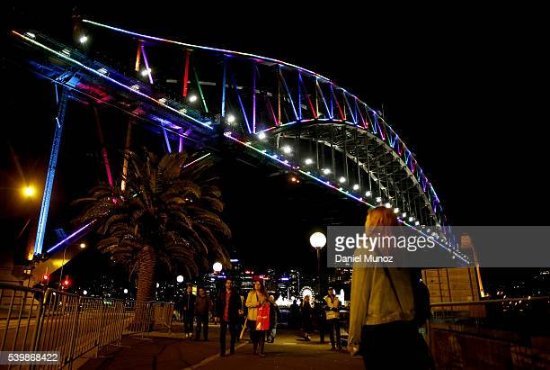 The Sydney Harbour Bridge is illuminated with rainbow colors to remember victims of the Orlando night club massacre on June 13, 2016 in Sydney,...