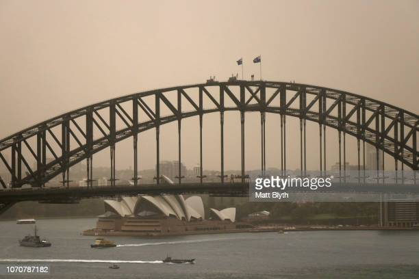 The Sydney Harbour Bridge is seen as a dust storm begins to roll into Sydney on November 22 2018 in Sydney Australia The State Government has issued...