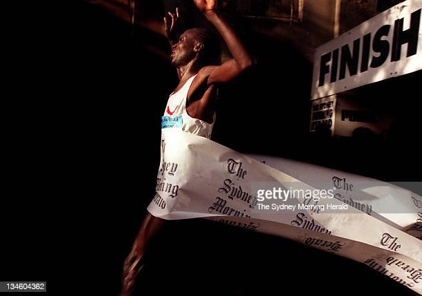 The Sydney Morning Herald Half Marathon winner Kenyan runner Stephen Kiogora crosses the finish line Picture taken 23 May 1999