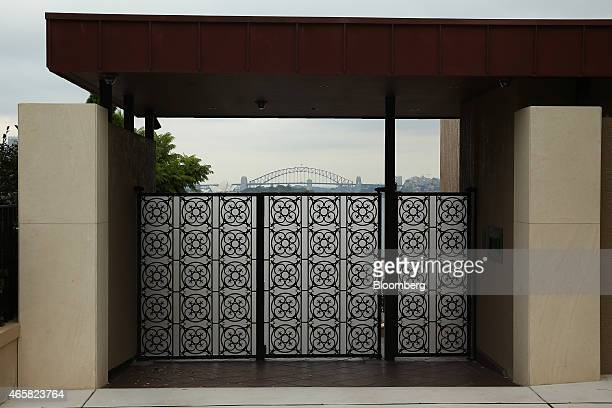 The Sydney Opera House and the Sydney Harbour Bridge are seen beyond the front gate of a residential property in the suburb of Point Piper in Sydney...